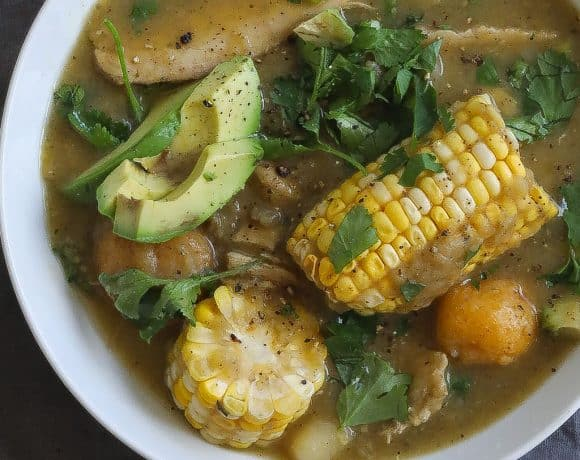 chicken and potato soup (ajiaco) with corn in a white bowl