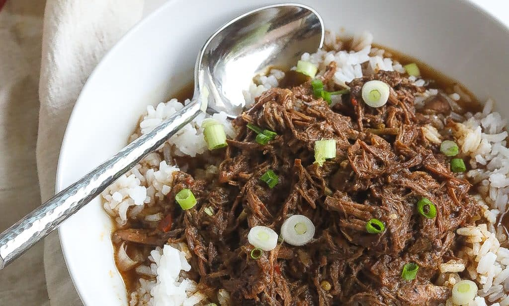 cajun rice and gravy with shredded beef in a bowl