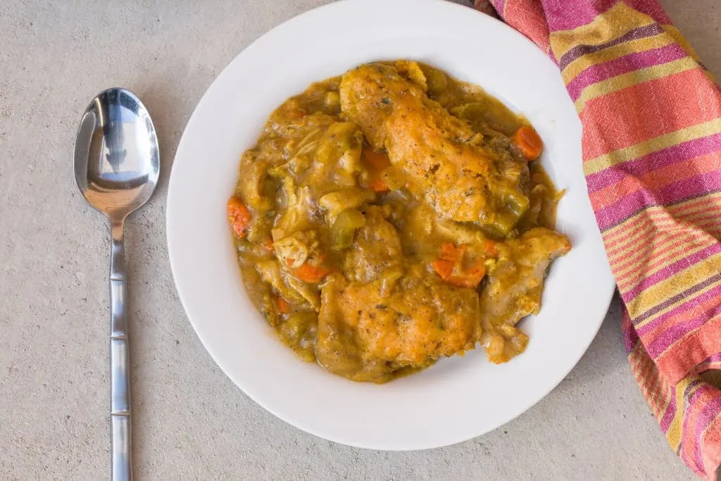chicken and dumplings in white bowl