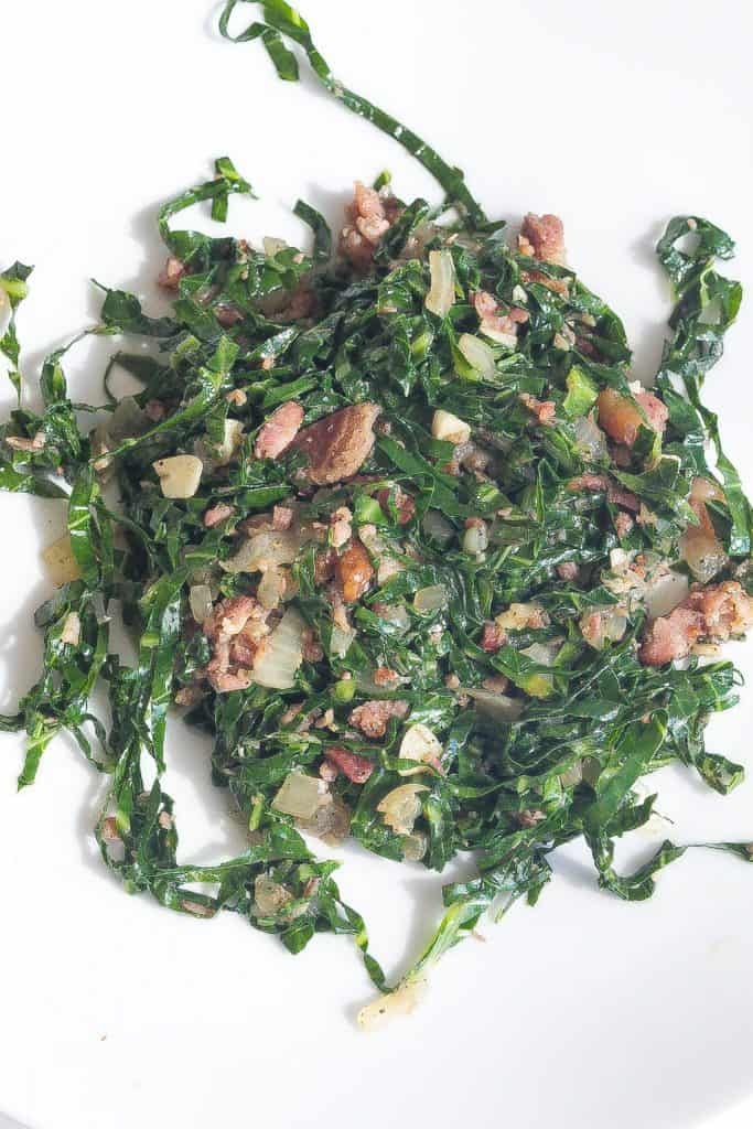 couve or brazilian collard greens on a white plate