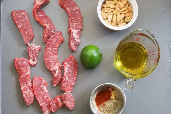 beef suya ingredients on a tray