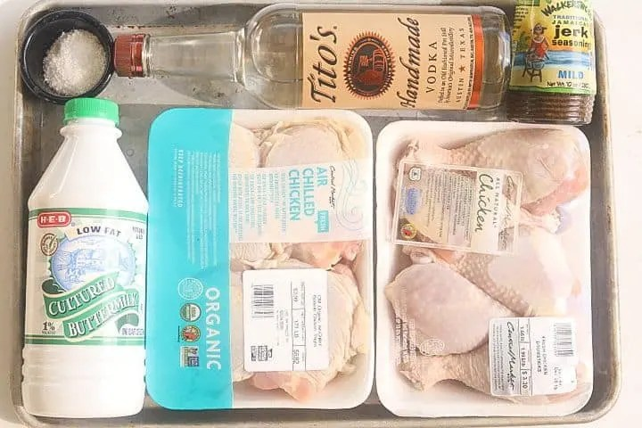 ingredients for fried chicken on a tray