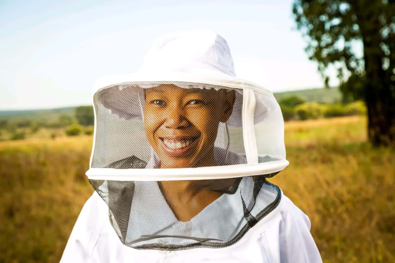 Third generation beekeeper inherits father's 450 beehives. Photo Credit: Optix Legacy