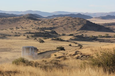 The school bus makes its way through the veld on rough roads every day, bringing children to Umthombo Wolwazi Farm School outside Colesberg in the Northern Cape.