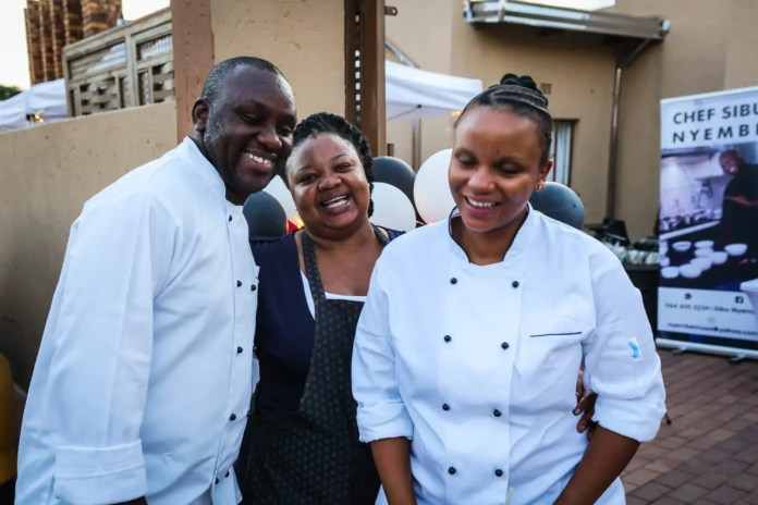 Nyembe, his mother Zodwa and wife Boitumelo.