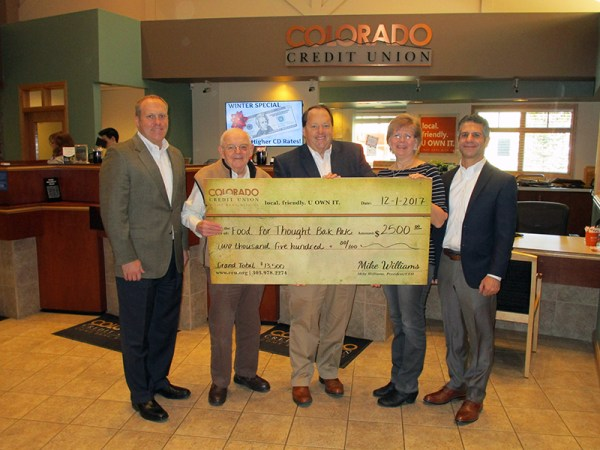 Colorado Credit Union presents a check for $2500