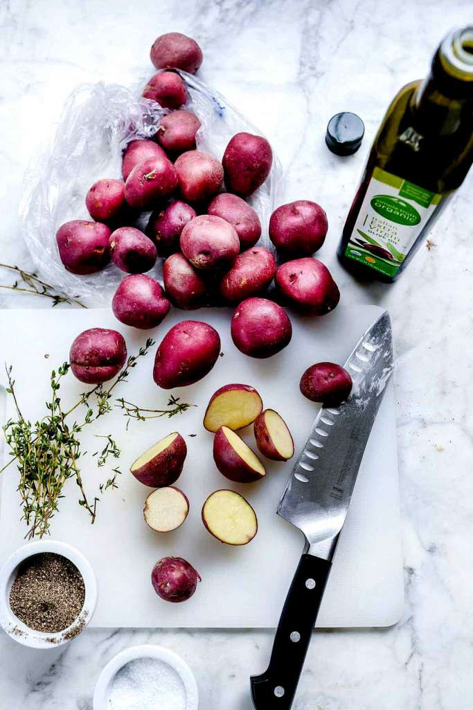 oven roasted potatoes ingredients on marble countertop