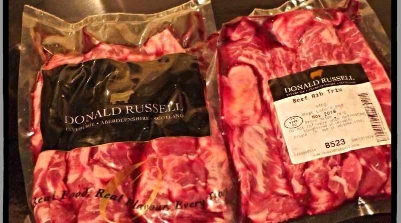 Donald Russell butcher beef rib trim
