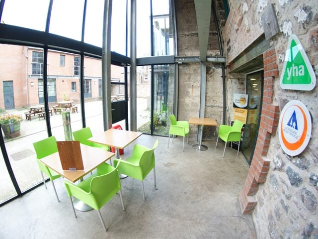 YHA Berwick - Glass-fronted area looking out into courtyard