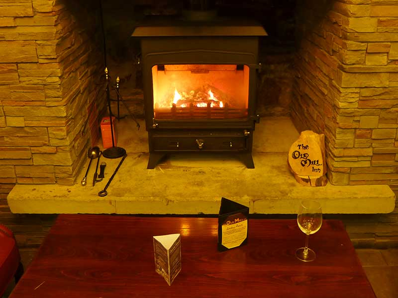 Cosy fireplace at the Old Mill Inn