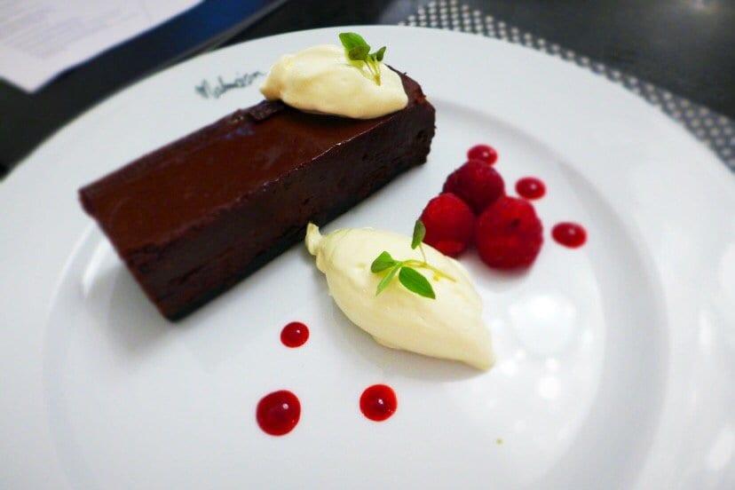 Malmaison glasgow summer menuValrhona chocolate truffle tart, creme fraiche and fresh raspberries.