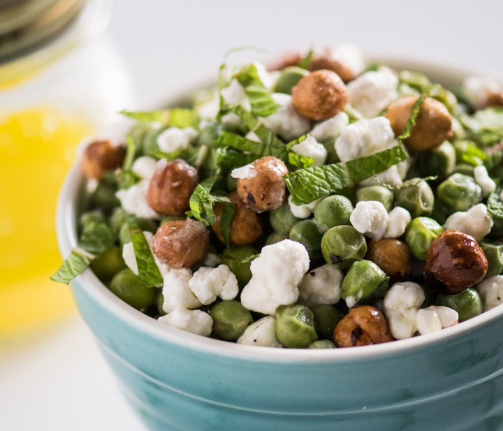 This salad made with fresh English peas is topped with goat cheese, candied hazelnuts and a meyer lemon vinaigrette for the ultimate springtime salad or light weeknight meal!