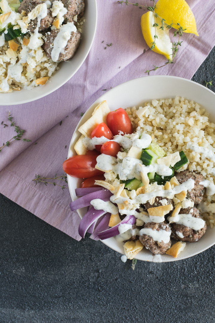 These Greek inspired gyro bowls are packed with flavor from the combination of lamb meatballs, feta, cauliflower rice and tzatziki sauce!