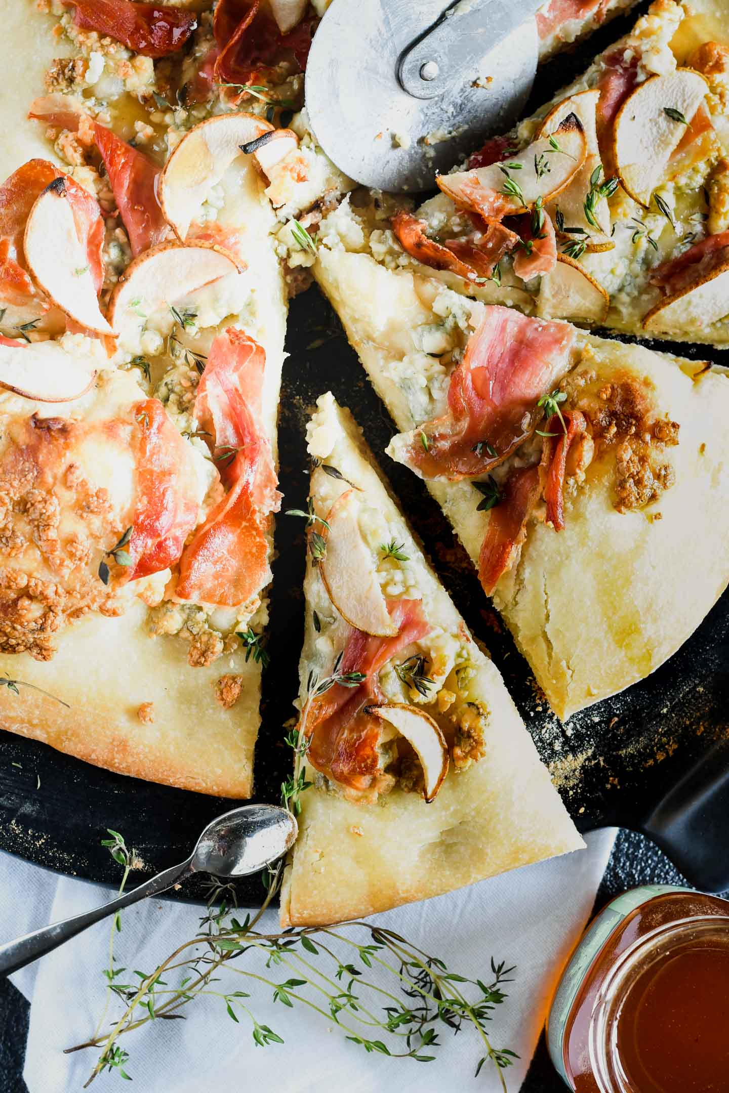 This grilled proscuitto, pear and blue cheese pizza has an extra crisp crust giving you a great end of summer meal.