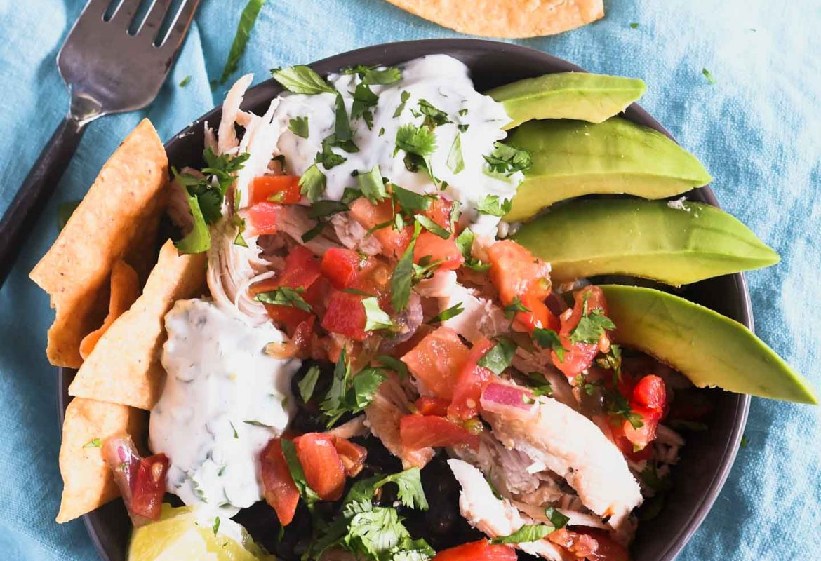 This Chipotle Chicken Burrito Bowl provides an amazing combination of flavors and an extra kick from the cilantro lime sauce for a healthy lunch or dinner!