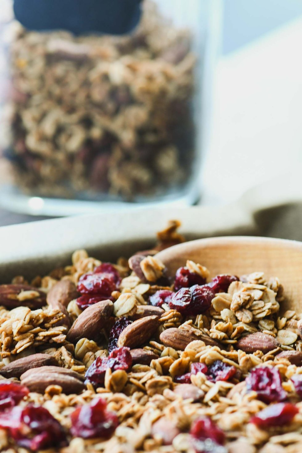 Honey flax granola with dried cranberries on a baking sheet