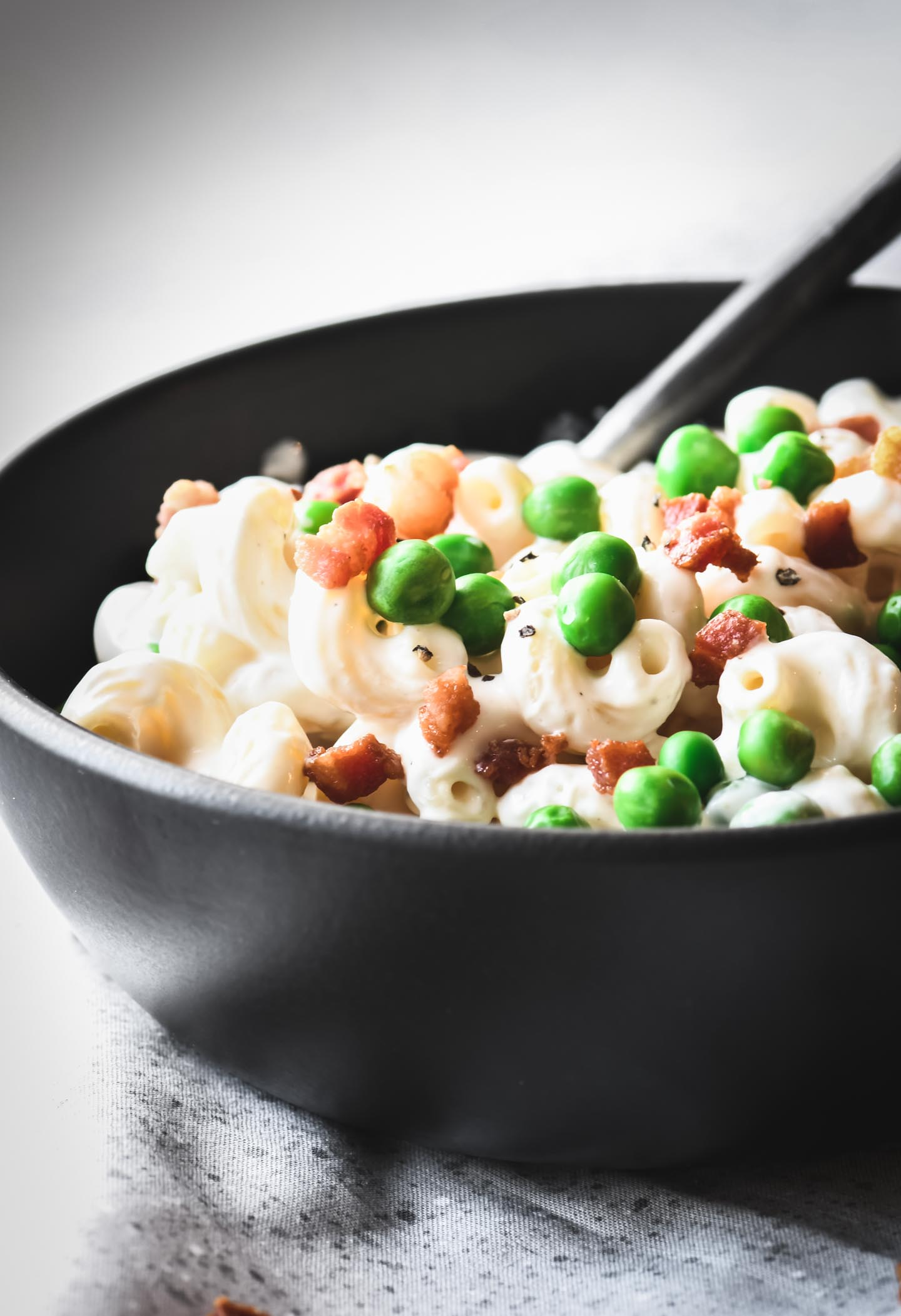 Greek Yogurt Mac & Cheese | Fusilli pasta with creamy cheese sauce, peas and crispy pancetta