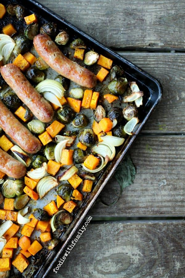 Roasted Fall Vegetable and Italian Sausage Sheet Pan Meal with Brussels sprouts, butternut squash, and onions from foodiewithfamily.com