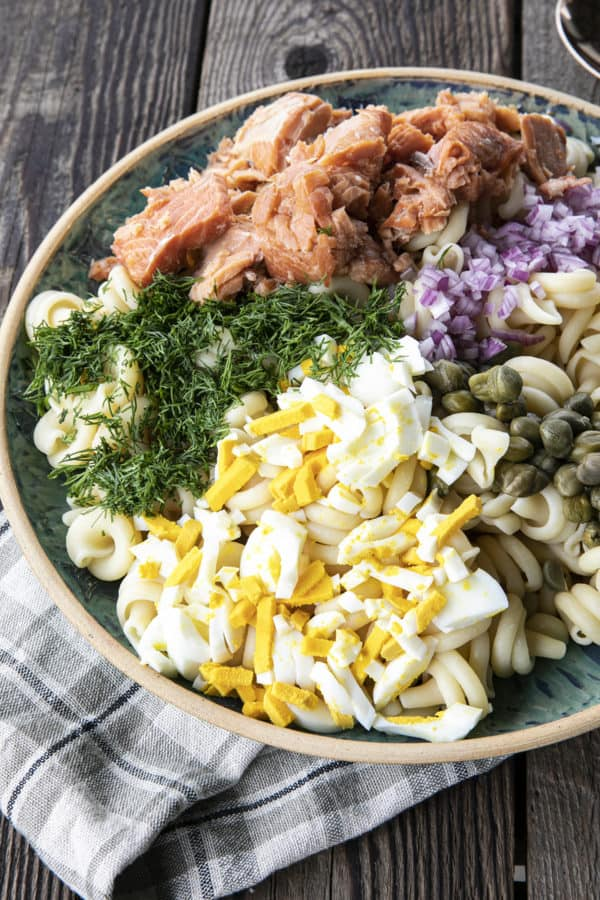 Smoked Salmon Pasta Salad is about to become your new favourite pasta salad. Savoury smoked salmon, a simple creamy dill dressing, hard-boiled eggs, capers, and red onions combine to amp up pasta salad to a whole new level. You'll find yourself craving this!