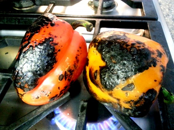 Charring peppers on an open flame gas stove