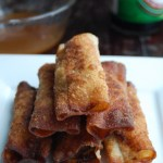 Stacked lumpia on plate.