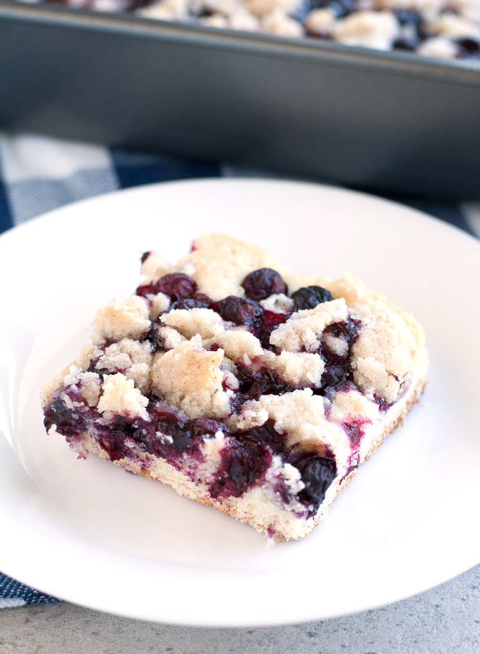 Slice of blueberry buckle on a plate