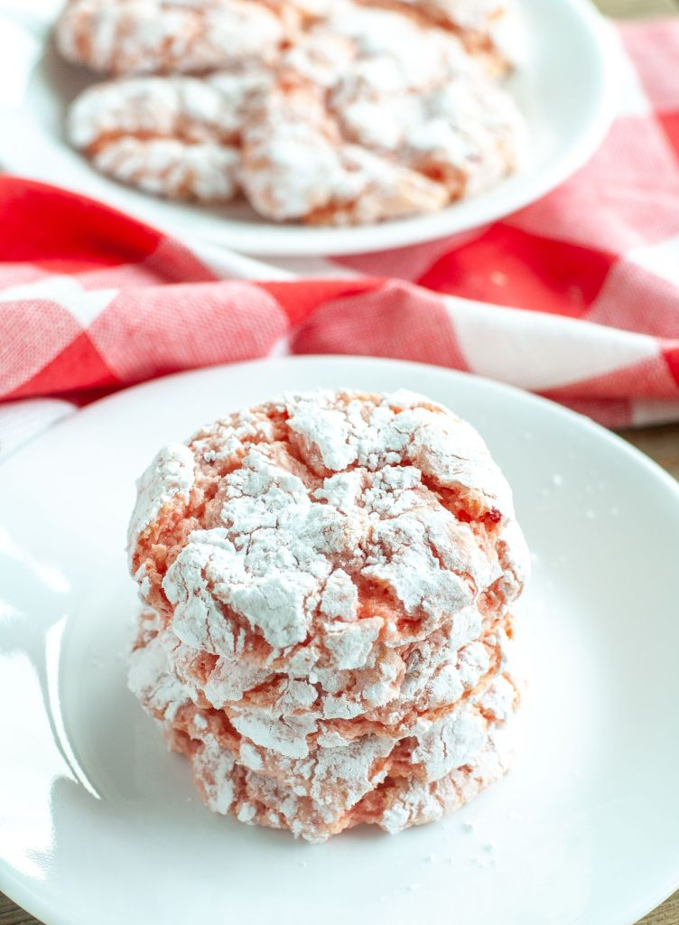 Strawberry Cookies Stacked on a white plate with red checked cloth behind