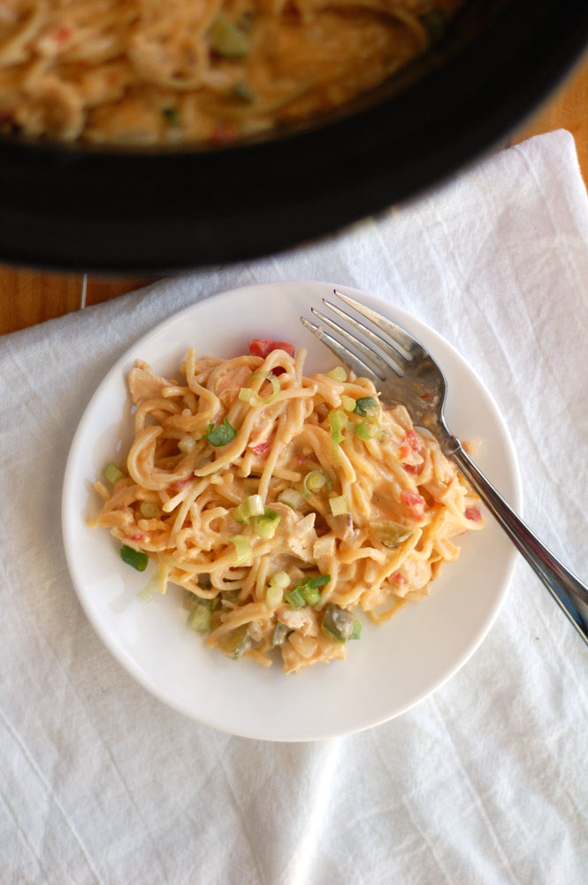 slow cooker chicken spaghetti on a white plate with a fork