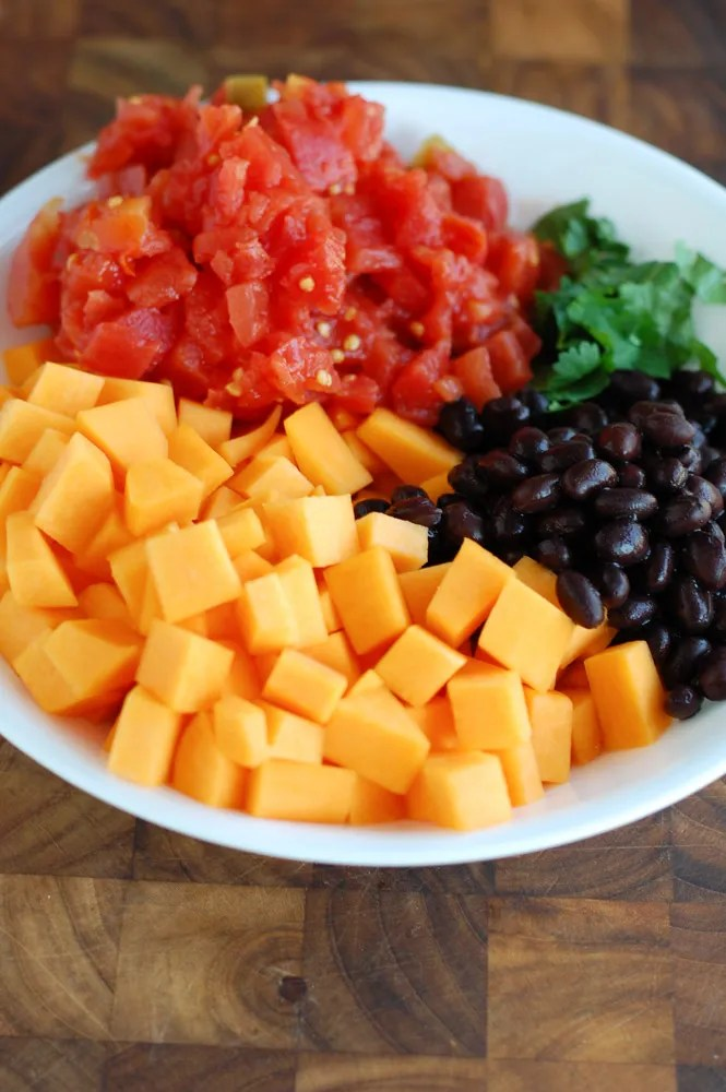 Butternut Squash and black bean enchiladas vitamin rich comfort food.