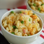 Macaroni and Cheese with ham and peas in bowl.