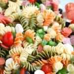 Bowl of tri-colored pasta salad.