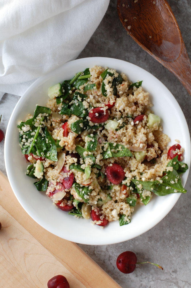 Cherry quinoa salad combines fresh sweet cherries, quinoa, spinach, almonds and blue cheese.