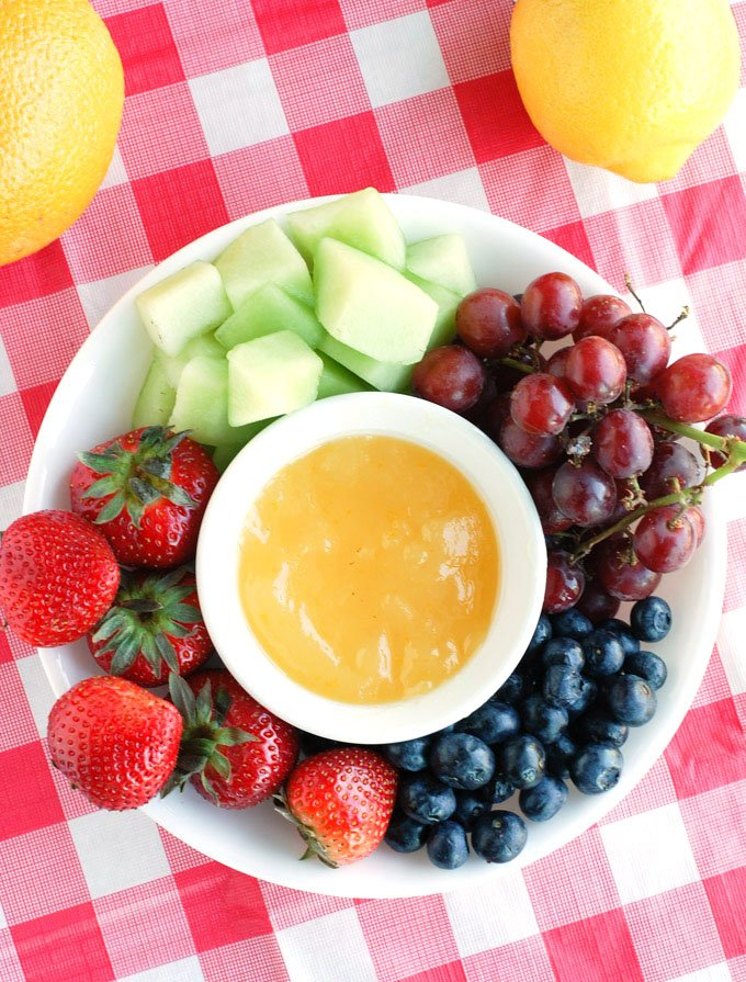 A refreshing orange dip that is perfect for dipping your summer fruit.
