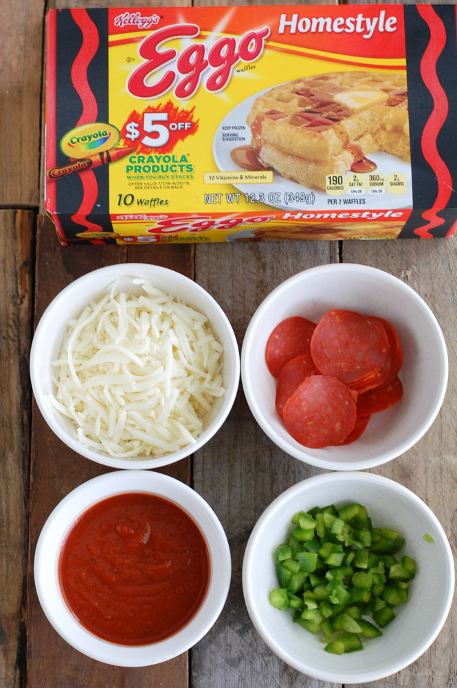 Turkey pepperoni, sauce, cheese and green peppers sandwiched between two waffles for the ultimate lunch or after school snack. These pizza waffle sandwiches are sure to be a hit with the whole family.