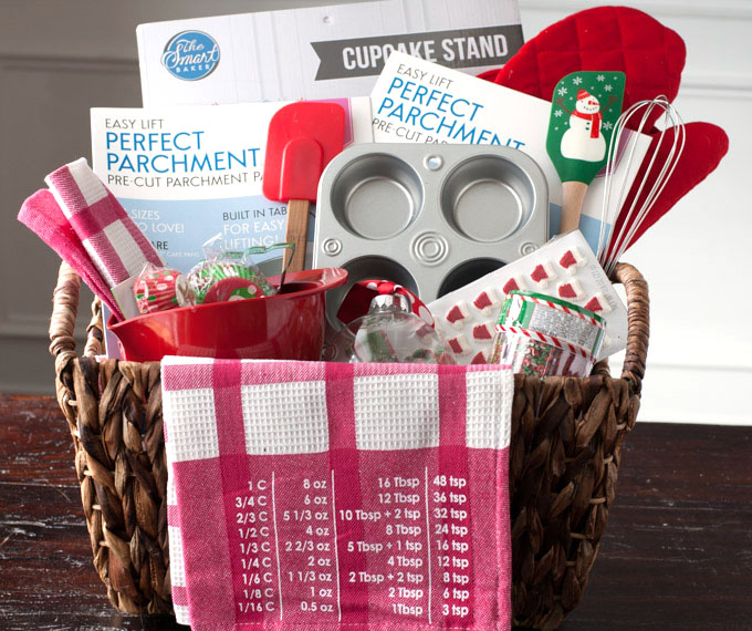 Basket with muffin tin, spatulas and towels.
