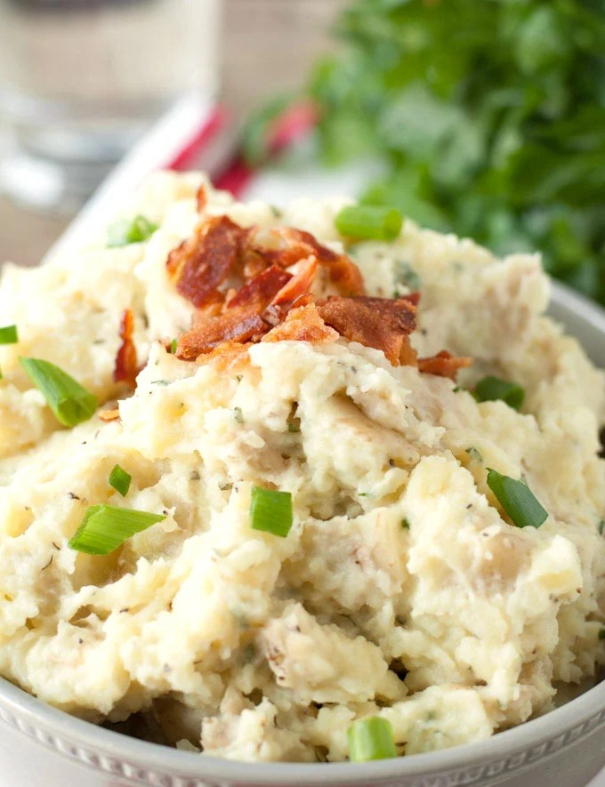 Golden mashed potatoes are all dressed up with ranch seasonings, cheese and bacon.