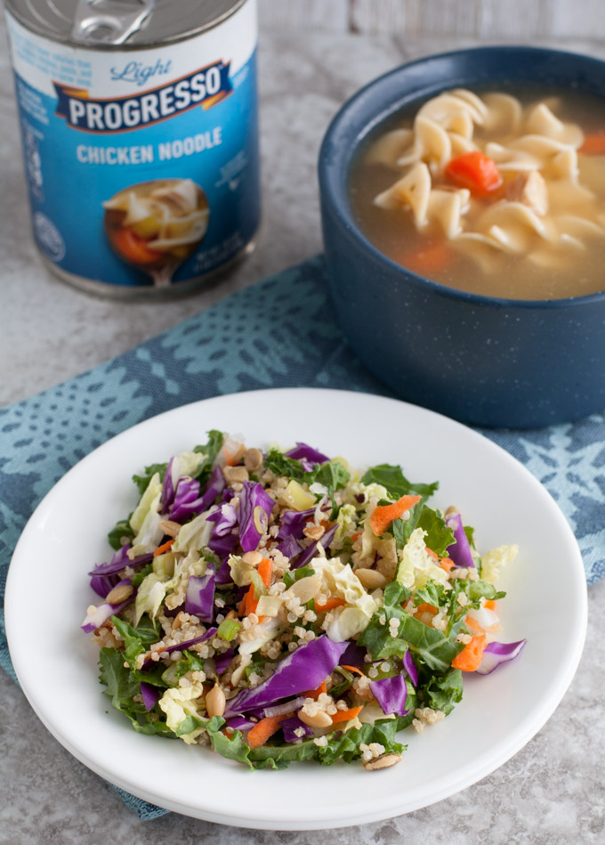 Quinoa salad on a plate with a bowl of soup in blue bowl.