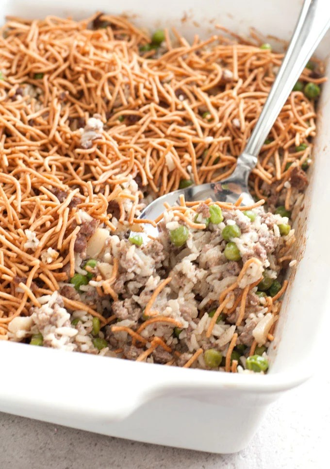 Asian Beef and Rice Casserole with crispy chow mein noodles and serving spoon