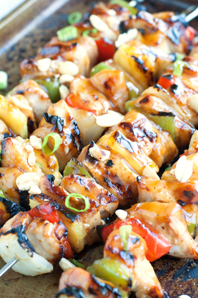 Kung Pao Chicken Skewers on a cookie sheet