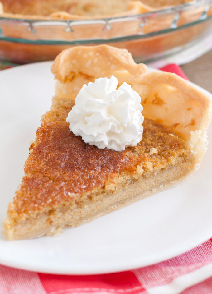 a piece of brown sugar chess pie with whipped cream