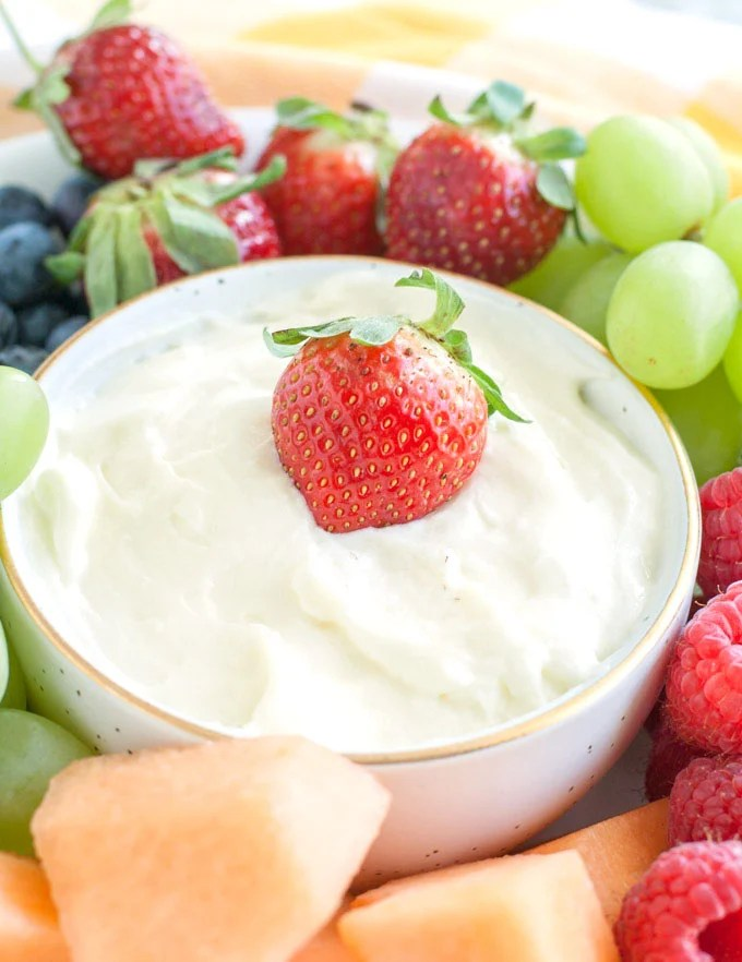Fruit dip in a bowl with a strawberry on top