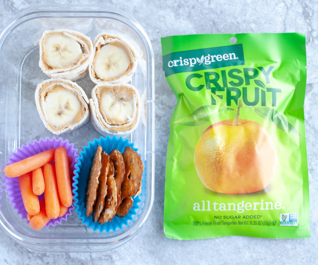 Container with banana roll ups, carrots and pretzels