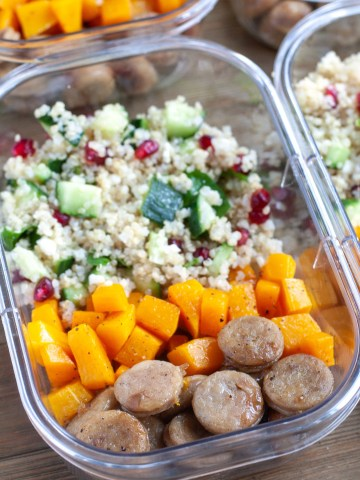 Container with sausage, butternut squash and quinoa salad.
