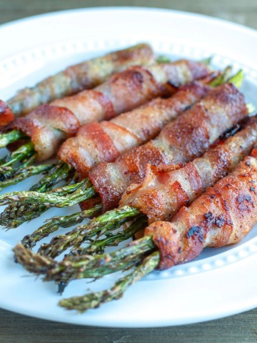Bacon wrapped asparagus on plate.