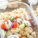 Containers with sausage, cucumbers, tomatoes and couscous.
