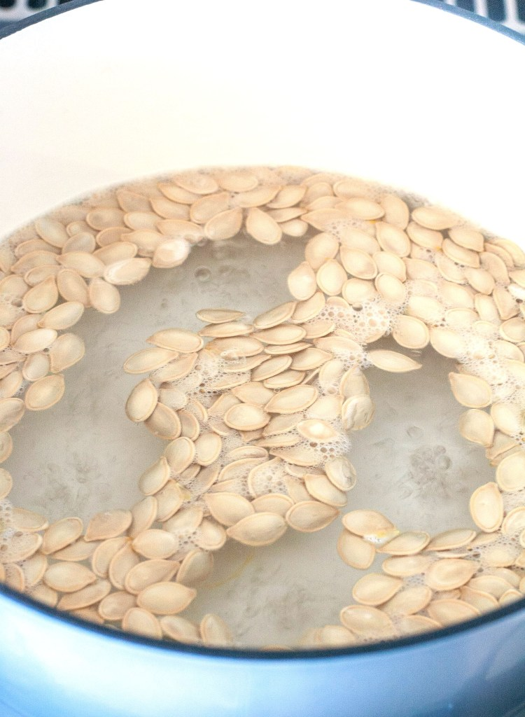 Pumpkin Seeds in a pot of boiling water