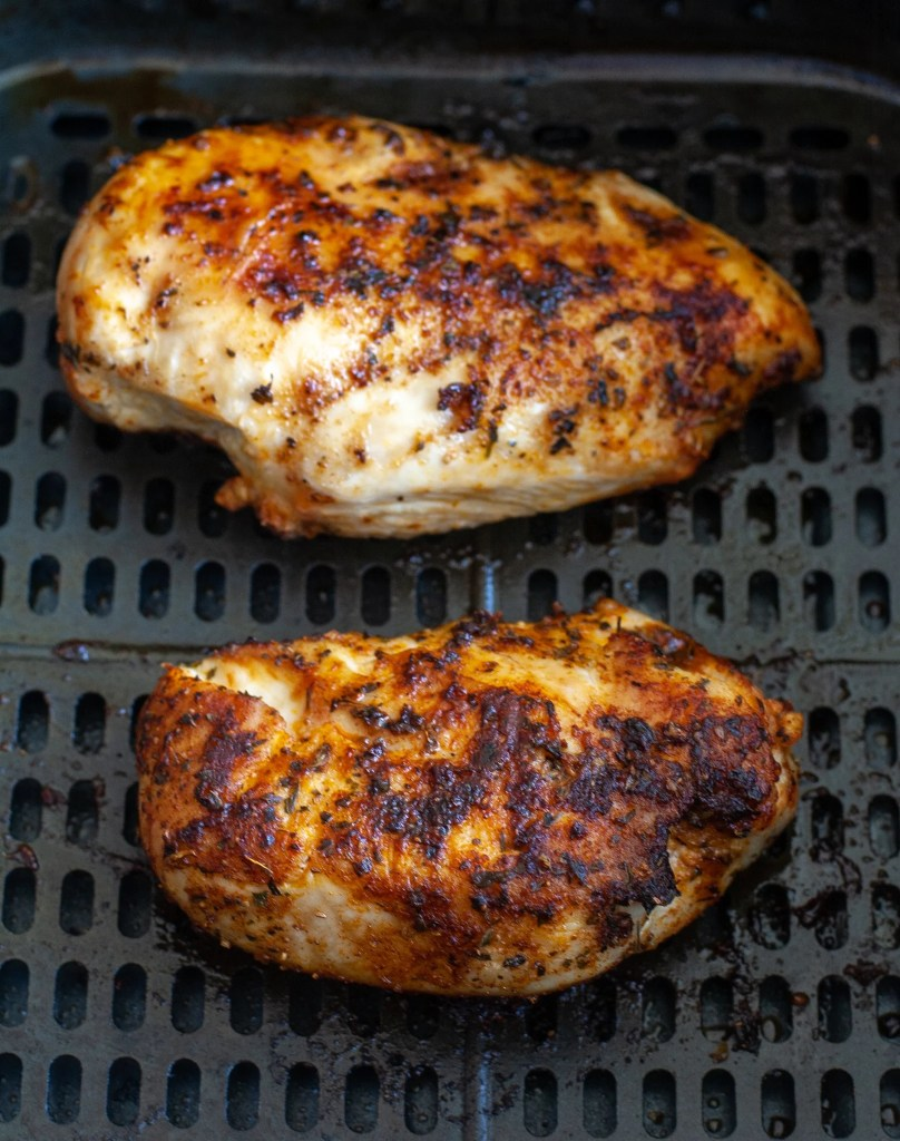 Cooked chicken in air fryer basket