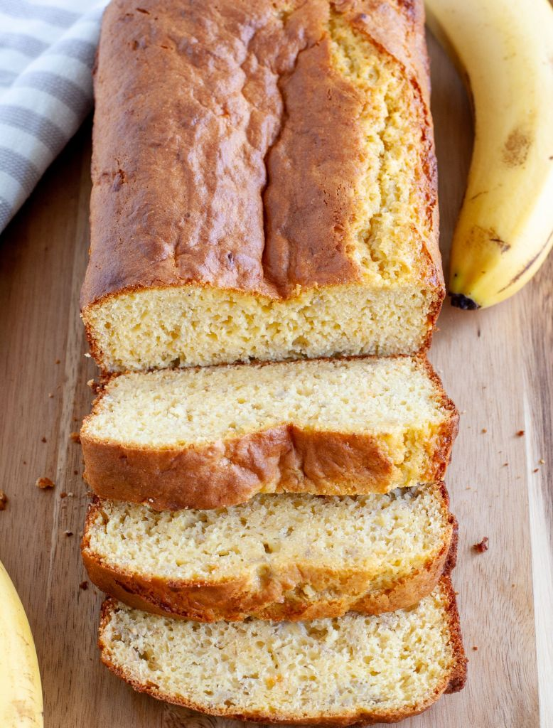 cake mix banana bread on a board with bananas on the side