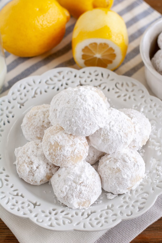 snowball cookies stacked on plate