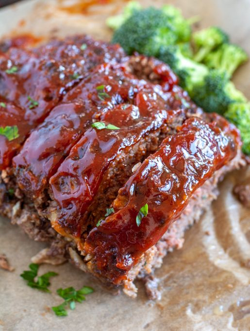 meatloaf on parchment paper with broccoli